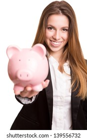 Smiling business woman with a piggy bank over white background