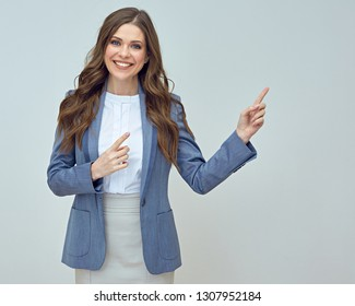 Smiling business woman pointing with finger. Isolated studio portrait.
