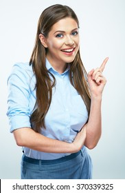 Smiling business woman pointing finger. Isolated portrait of female business model with long hair