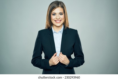 smiling business woman portrait in black suit. studio isolated.