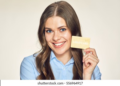 smiling business woman presenting gold credit card. isolated portrait.