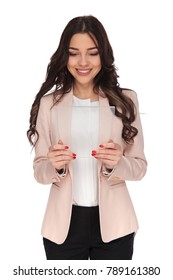 smiling business woman reading on a futuristic transparent tablet on white background