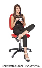 Smiling business woman relaxed with coffee cup sitting in office chair, isolated on white background