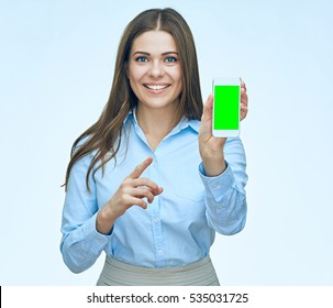 Smiling business woman show screen  mobile phone. Pointing finger. isolated portrait. Long hair.