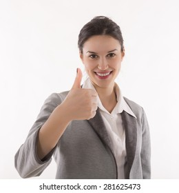 Smiling business woman with thumb up gesture, isolated on white background