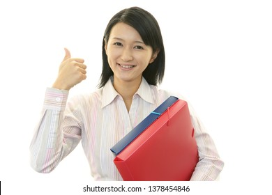 Smiling business woman with thumbs up.