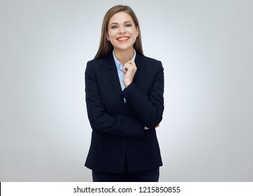 Smiling business woman wearing black suit isolated studio portrait.