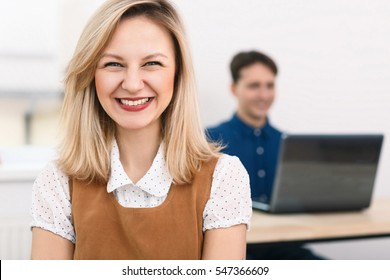 Smiling business woman with working man on a background