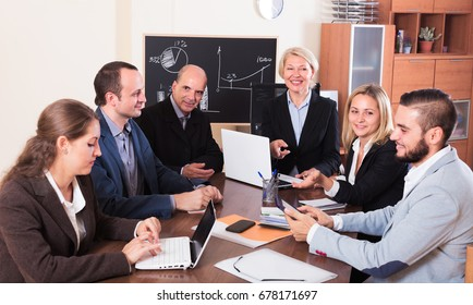 Smiling business worker during conference call indoors