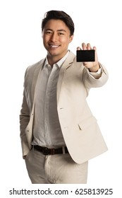 Smiling businessman in a bright suit holding a up a black membership card. Standing in front of a white background.