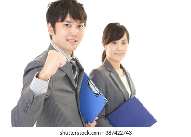 Smiling businessman and businesswoman