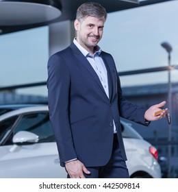 Smiling businessman buying car