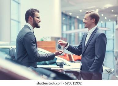 Smiling businessman with car keys