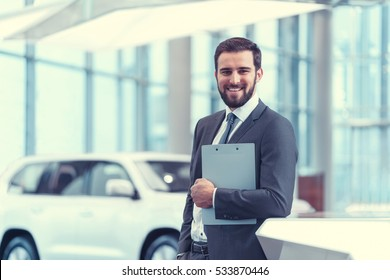 Smiling businessman with clipboard