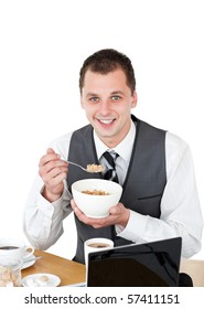 Smiling businessman eating cereals looking at the camera against white background