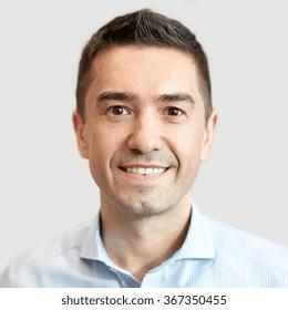 smiling businessman face or portrait