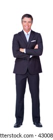Smiling businessman with folded arms isolated on a white background