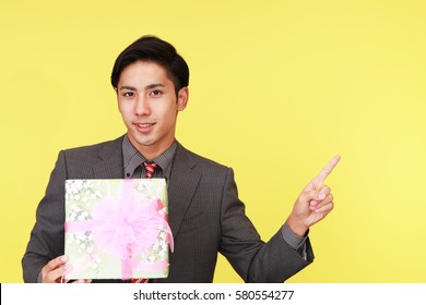 Smiling businessman with a gift