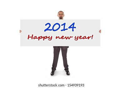 Smiling businessman holding a really big card, isolated on white, happy new year
