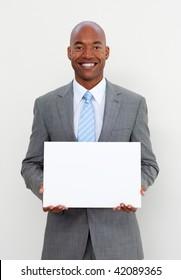 Smiling businessman holding white card isolated on white background