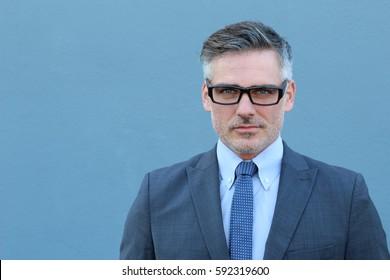 Smiling businessman isolated on blue background
