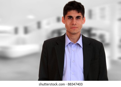Smiling businessman  with light business background