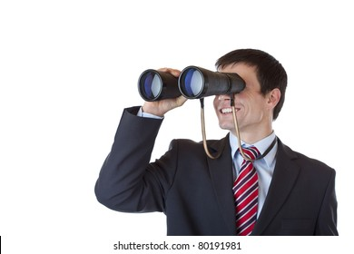 Smiling businessman looks through binoculars and espies success.Isolated on white background