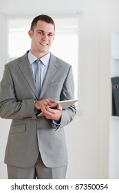 Smiling businessman pointing at his notes