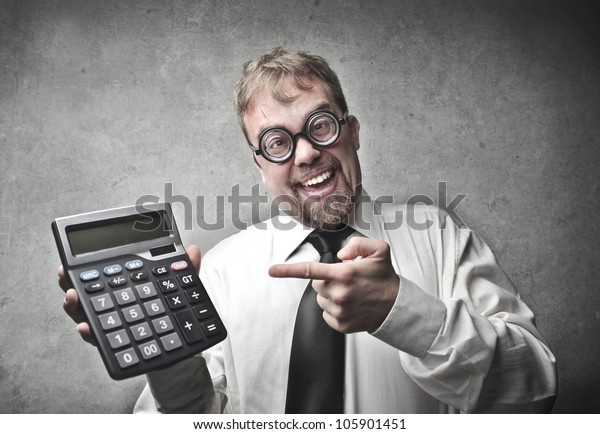 Smiling businessman showing a calculator