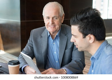 Smiling businessman showing online report