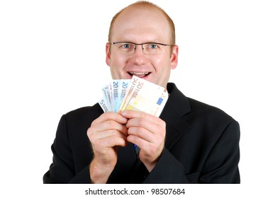 smiling businessman with some euro bills