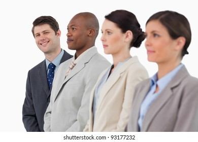 Smiling businessman standing next to his colleagues against a white background