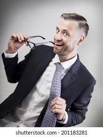 smiling businessman takes tie