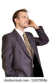 Smiling businessman talks on phone isolated on white