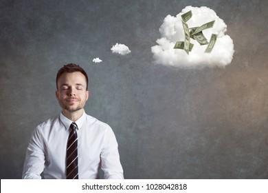 Smiling businessman thinking of money