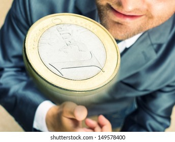 Smiling businessman tossing a coin