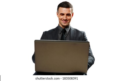 Smiling businessman using laptop isolated on a white background