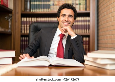 Smiling businessman at work in his office