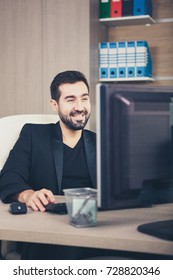 Smiling Businessman working in his office. Businessperson in professional environment