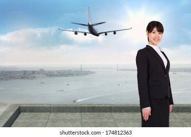 Smiling businesswoman against coastline city