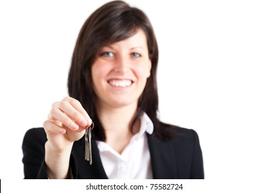 Smiling businesswoman is giving you keys