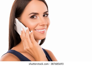 Smiling businesswoman having a conversation and holding phone