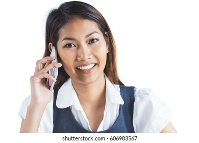 Smiling businesswoman having a phone call on white background