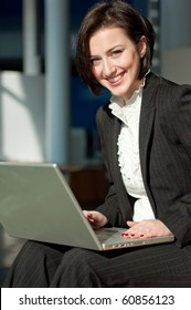 Smiling businesswoman with a laptop