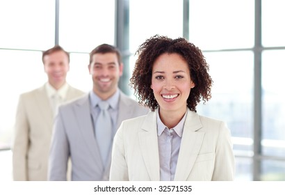 Smiling businesswoman in a line with her colleagues