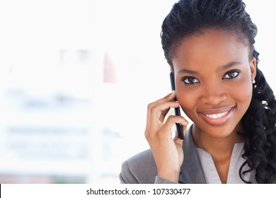 Smiling businesswoman looking ahead while talking on a phone