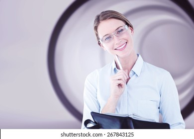 Smiling businesswoman looking at camera against abstract white room
