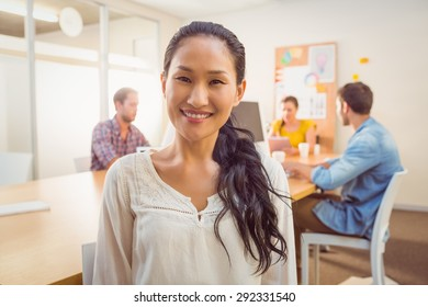 Smiling businesswoman looking at the camera in the office