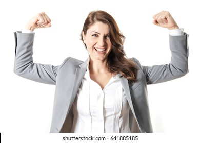 A smiling businesswoman making strong arms gesture