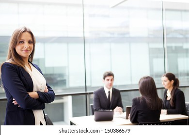 Smiling businesswoman on the foreground of his team